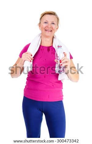 Image of old senior woman in sport outfit with white towel on her neck drinking water after fitness exercises, isolated on white background, Positive human emotions - stock photo