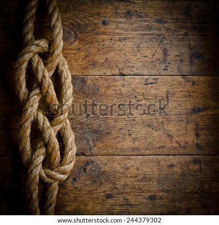 Image of old texture of wooden boards with ship rope. - stock photo