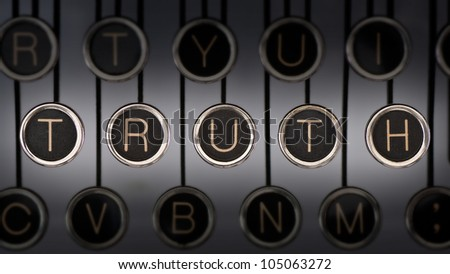 "Image of old typewriter keyboard with scratched chrome keys that spell out the word ""TRUTH"". Lighting and focus are centered on ""TRUTH""."