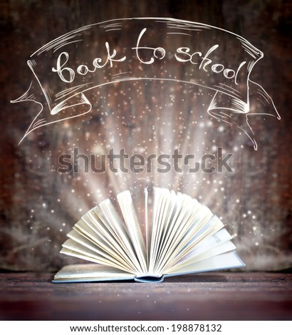 "Image of opened magic book with magic lights/ ""Back to school""background/ Education concept background - stock photo"