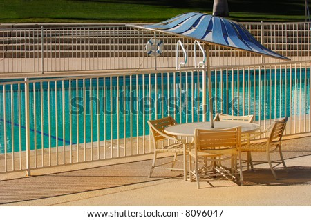 Image of outdoor table and chairs by the pool