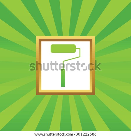 Image of paint roller in golden frame, on green abstract background - stock photo