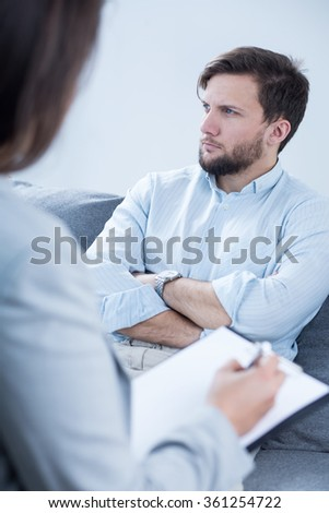 Image of patient talking with psychiatrist during psychotherapy - stock photo