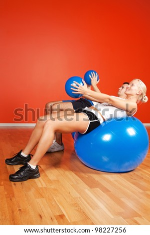 Image of people doing exercise with fitness balls - stock photo