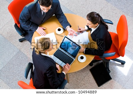 Image of people gathered together discussing a new project - stock photo