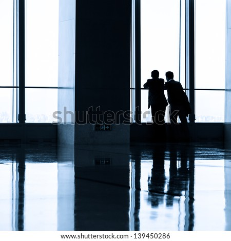 Image of People silhouettes at office building - stock photo