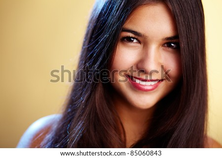 Image of perfect woman looking at camera with smile - stock photo