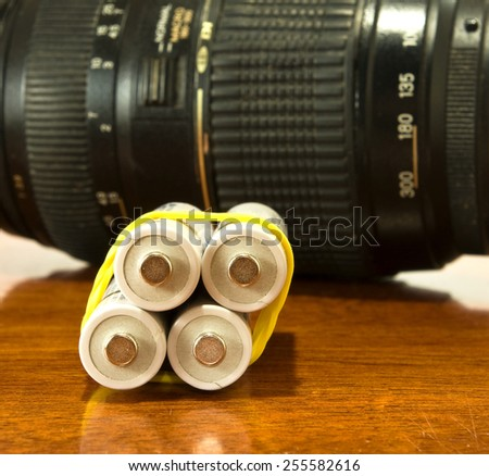 image of photo lens and accumulators - stock photo