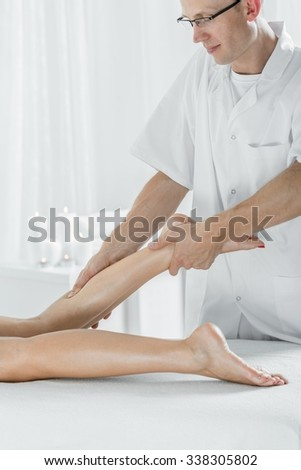 Image of physiotherapist doing massage of calf