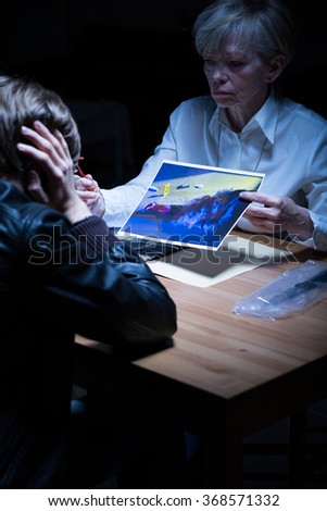 Image of police agent showing materials from crime scene - stock photo