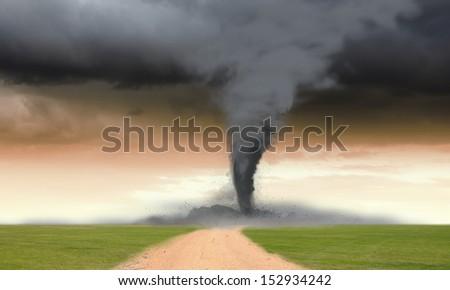 Image of powerful huge tornado twisting in meadow - stock photo