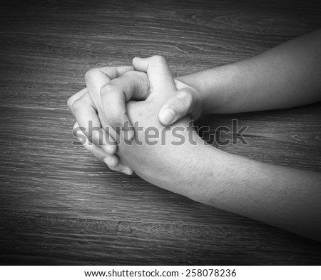Image of praying hands of a young asian man