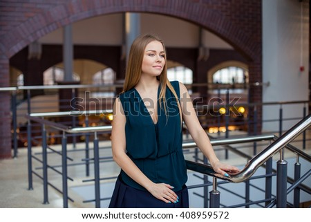Image of pretty businesswoman in office - stock photo