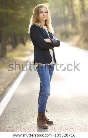 Image of pretty businesswoman looking at camera on natural space