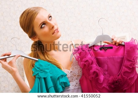 Image of pretty female thinking wat dress to wear on New Year night