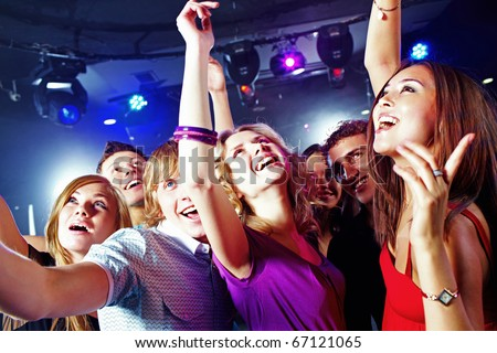 Image of pretty girls dancing with their boyfriends in night club