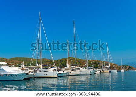 Image of pristine yachts and boats moored on the calm blue seas of the turkish riviera in mid summer