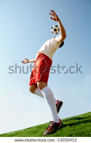 Image of professional sportsman playing football - stock photo