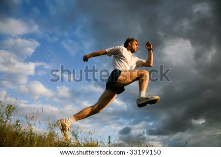 Image of pumped man training on open air - stock photo