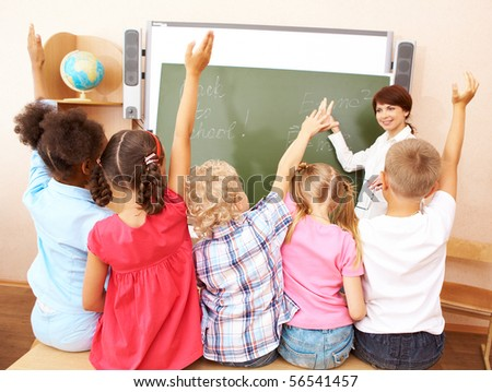 Image of pupils stretching their arms during the lesson - stock photo