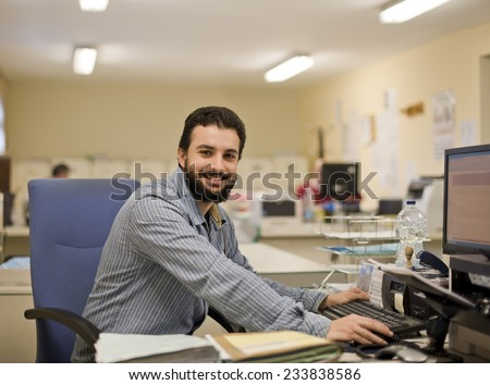 Image of real bearded office clerk working at office