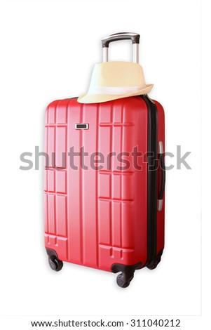 image of red elegant travel luggage and fedora hat isolated on white  - stock photo