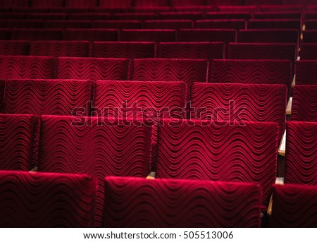 Image of red empty chairs in the theater