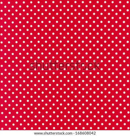 image of red fabric with white polka dots - stock photo