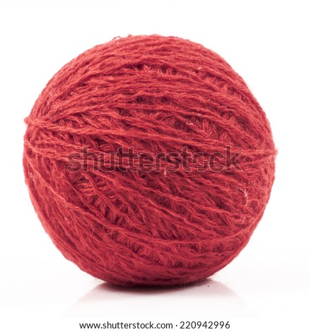 image of red wool ball isolated close up - stock photo