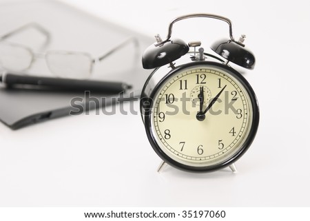 Image of retro alarm clock and business objects on workplace,Time concepts-Break Time