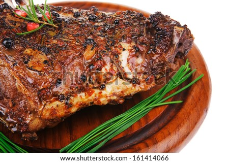 image of roasted ribs on wood over white