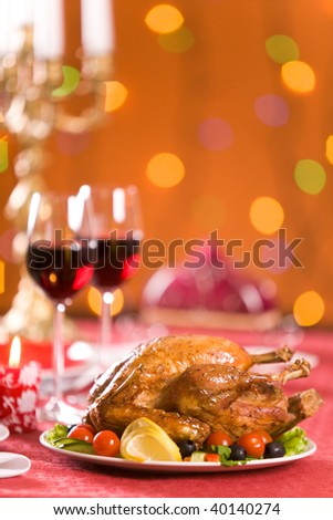Image of roasted turkey with vegs and red wine on Christmas table