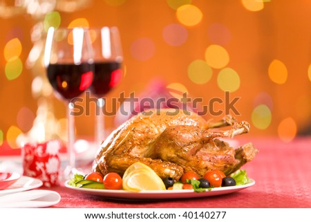 Image of roasted turkey with vegs and red wine on Christmas table - stock photo