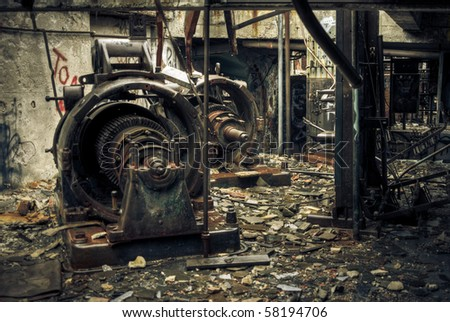 Image of rusty, old power equipment in an industrial abandoned train station. - stock photo