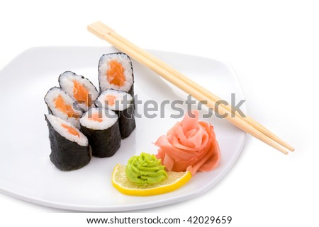 Image of sake hosomaki sushi with pickled ginger and wasabi on a plate