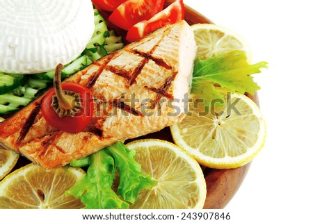image of salmon with lemon and tomatoes on wood