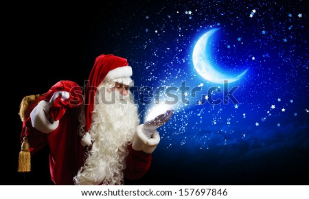 Image of Santa Claus against night sky background - stock photo