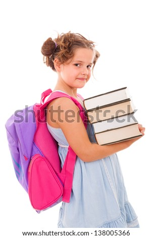 Image of schoolgirl with backpack carring books, isolated on white background - stock photo