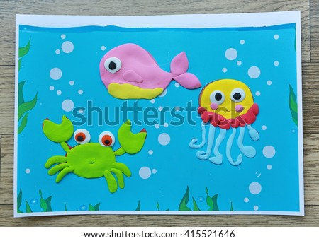 Image of sea animal by clay or plasticine on paper at kindergarten