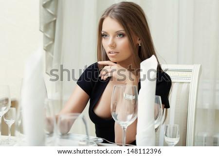 Image of seductive woman posing in restaurant - stock photo
