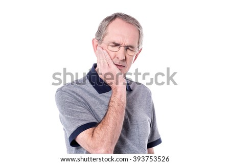 Image of senior man suffers from toothache - stock photo