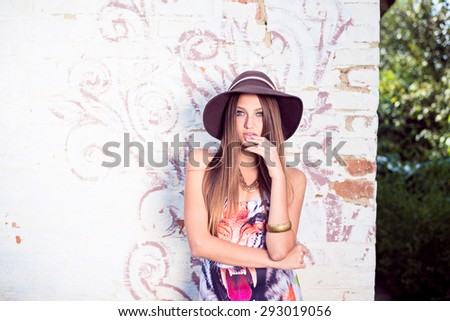 Image of sensual beautiful young lady having fun relaxing posing at wall on summer outdoors copy space background - stock photo