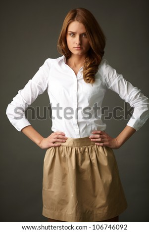 Image of serious woman in smart casual looking at camera - stock photo