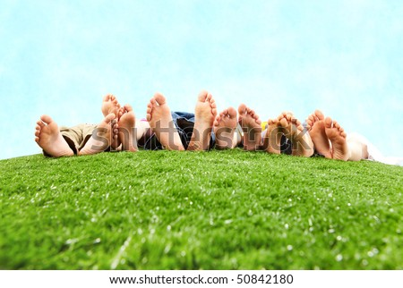 Image of several legs lying on the grass and resting - stock photo