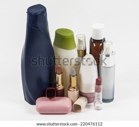 Image of shampoo bottles and lipstick isolated - stock photo
