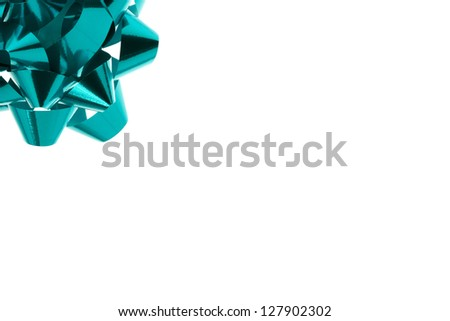 Image of shinny green bow on upper left corner with white background - stock photo