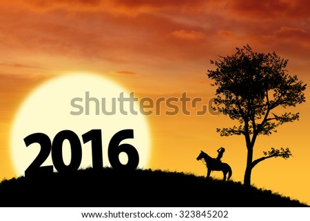 Image of silhouette woman riding horse on the hill while looking at number 2016 - stock photo