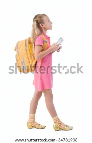 Image of smart schoolgirl with backpack going to school - stock photo