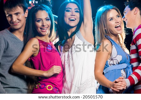 Image of smart teenagers dancing during party in night club and laughing - stock photo