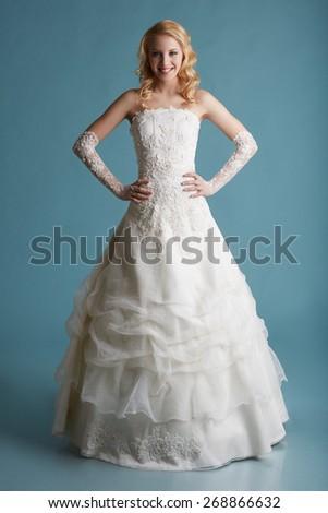 Image of smiling model touts elegant wedding dress - stock photo